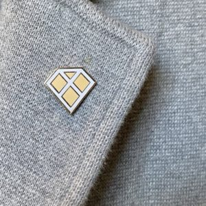 gem-x-lapel-pin-on-grey-lapel-800px
